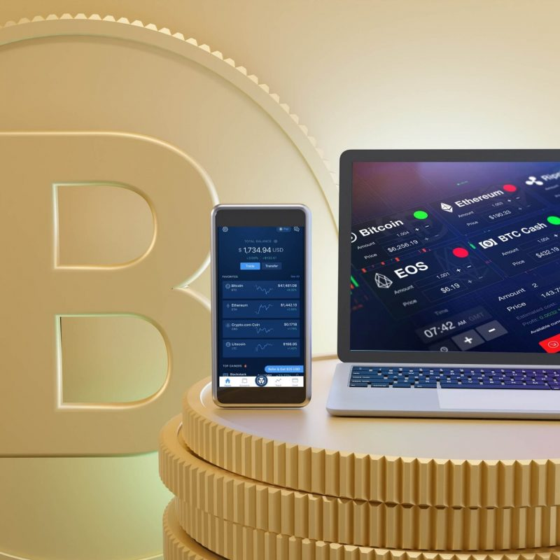 Smartphone mobile and laptop computer place on the golden coins with coin B text background. 3D rendering illustration image.